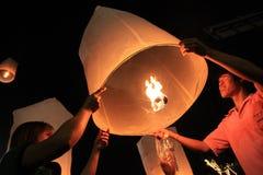 BANGKOK - DEC 5: King's Birthday Celebration - Thailand 2010. BANGKOK - DEC 5: People Holding a Burning Lantern at the King's Birthday Celebration - Bangkok Stock Image