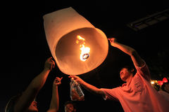 BANGKOK - DEC 5: King's Birthday Celebration - Thailand 2010. BANGKOK - DEC 5: People Holding a Burning Lantern at the King's Birthday Celebration - Bangkok Stock Photo