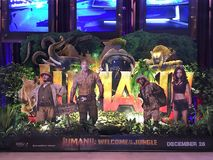 Poster of Jumanji: Welcome to the Jungle in Bangkok. BANGKOK - DEC 13, 2017: A poster of Jumanji: Welcome to the Jungle in Paragon Cineplex in Siam Paragon mall Stock Photography