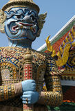 Bangkok Demon. A gaudy statue of the Yaksha Demon guarding the main entrance of Wat Phra Kaeo in Bangkok, Thailand Stock Images