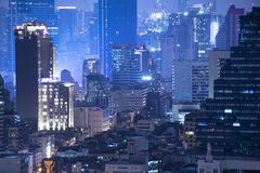 Bangkok density residential at night. In down town skyscraper area royalty free stock images