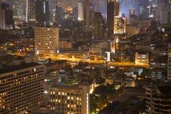Bangkok density residential at night. In down town skyscraper area stock photos