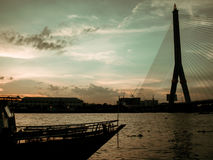 Bangkok dinner cruise at Chao Pra Ya river view in sunset. Royalty Free Stock Photos