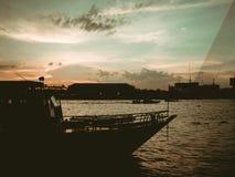 Bangkok dinner cruise at Chao Pra Ya river view in sunset. Stock Photo