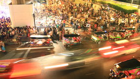 Bangkok downtown busy traffic, time lapse at night. Bangkok downtown busy traffic at Siam center, people travel by tuk-tuk, taxi and bus, time lapse at night stock footage
