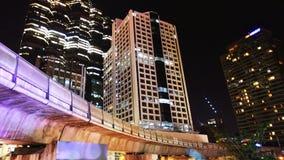 Bangkok city at night. Skytrain and skyscraper stock footage