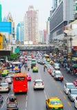 Bangkok downtown. BANGKOK, THAILAND - MARCH 26, 2012: Trafiic on Bangkok downtown road during rush hour Stock Photo