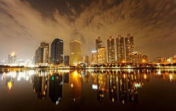 Bangkok in evening, reflection of buildings in water Stock Photography