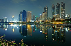 Bangkok in evening, reflection of buildings in water Royalty Free Stock Photography