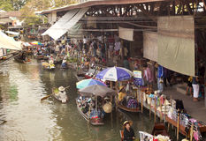 Bangkok Floating Market. The famous Damnoen Saduak floating market near Bangkok Thailand. Used in many movies like Man with the Golden Gun (James Bond) and Royalty Free Stock Photos