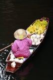 Bangkok Floating Market. A woman selling fruits at Bangkok floating market Royalty Free Stock Images