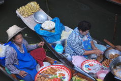 Bangkok Floating Market. In Thailand, Asia  - boats piled high with tropical fruit and vegetables, fresh, ready-to-drink coconut juice and local food cooked Stock Photos