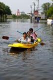 Bangkok Flooding 2011. Thai people row a boat on the flooding road ,Bangkok Flooding 20 Royalty Free Stock Photo