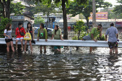 Bangkok Floods. Flood victims wait for food supplies on a flooded road on November 4, 2011 in Bangkok, Thailand. Months of monsoon rain have flooded a fifth of Royalty Free Stock Photography