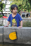 Bangkok Floods. A child looks on at a flooded road in Pinklao district on November 4, 2011 in Bangkok, Thailand. Approximately a fifth of the Thai capital is Royalty Free Stock Photography
