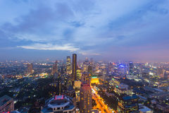 Bangkok glowing cityscape at dusk with scenic sky Stock Photos