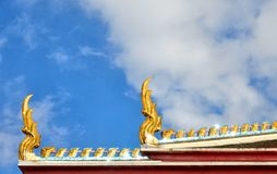 Bangkok gold temple ornaments with blue cloudy sky. In Thailand Asia Royalty Free Stock Photos