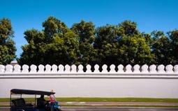 Bangkok Grand Palace wall and Tuk Tuk in front. Tuk Tuk in front of Bangkok Grand Palace wall Stock Image