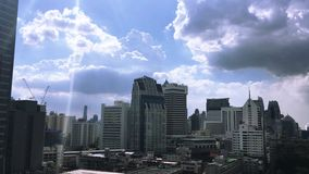 Bangkok High rise hotel and apartment,. Camera panning up to the sun in heavenly sky stock video