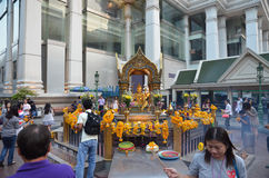 BANGKOK - JAN 2014:  People pray respect the shrine of the four-faced Brahma statue Stock Photo