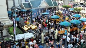 Foreigners and local people visit Erawan Shrine stock video