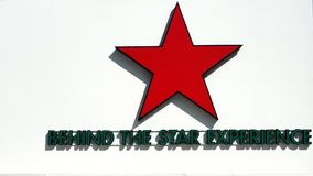 Heineken five-pointed red star and tag line. BANGKOK - JANUARY 1, 2018: Heineken five-pointed red star and tag line on wooden wall at a Beer Garden in front of stock photos