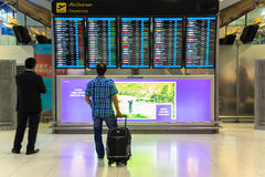 BANGKOK - JANUARY 8  Passengers checking the flight schedule on airport charts at Suvarnabhumi Airport , on 8 January, 2015 in Ban Royalty Free Stock Image