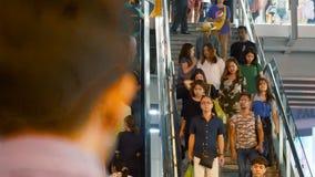People go down the escalator. BANGKOK - JANUARY 31, 2018: People go up the escalator at the street on january 31, 2018 in Bangkok, Thailand stock footage