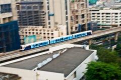 Sky Train in motion between stations NANA and ASHOKA in Bangkok Stock Image