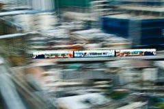Sky Train in motion between stations NANA and ASHOKA in Bangkok Royalty Free Stock Photo