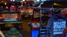 Heavy rush hour traffic. BANGKOK - JANUARY 31, 2018: Tuk-tuk takes tourists during heavy rush hour traffic in Bangkok on january 31, 2018 in Bangkok, Thailand stock video footage