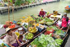 Farmer selling fruit vegetable and food on boats. Royalty Free Stock Images