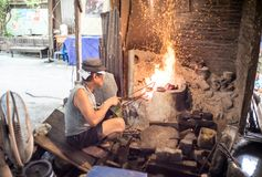 Bangkok - June 5,2017: The man was marking monk`s bowl or almsbowl in Baan Bu Bronzework Community. stock image
