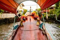 Bangkok leisure time. Trip through Bangkok canals down the Chao Phraya river on longtail boat royalty free stock photo