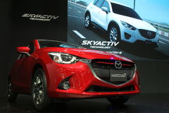 Bangkok - March 31 : Mazda 2 on red car at The 37th Bangkok International Thailand Motor Show 2016 on March 26 Stock Photos