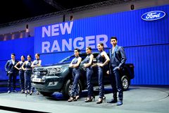 BANGKOK - March 26 : New Ford Ranger, Pick up truck, with male a Royalty Free Stock Image