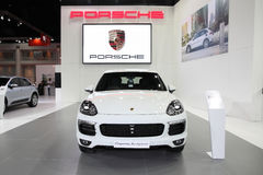 BANGKOK - MARCH 24: Porsche Cayenne Hybrid  car on display at Th Royalty Free Stock Images
