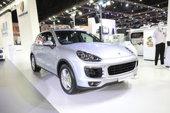 BANGKOK - MARCH 24: Porsche Cayenne Hybrid  car on display at Th Royalty Free Stock Photography
