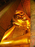 BANGKOK - MARCH 16. Reclining Buddha in Wat Pho temple on March 16, 2012 in Bangkok, Thailand. Wat Pho is named after a monastery Royalty Free Stock Image