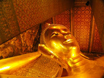 BANGKOK - MARCH 16. Reclining Buddha in Wat Pho temple on March 16, 2012 in Bangkok, Thailand. Wat Pho is named after a monastery Stock Photo