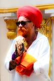 Sikh devotee with red turban at Gurdwara Siri Guru Singh Sabha. Royalty Free Stock Photos