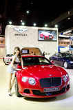 BANGKOK - MARCH 29 : Unidentified model with BENTLEY Continantal Stock Images