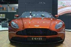 Bangkok - mars 31: Aston svalaspökbild 007 DB11 på den orange bilen på den 37th Bangkok internationella Thailand motoriska showen Arkivfoto