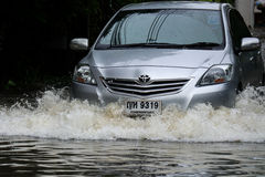 BANGKOK - May 25: A people evacuates from the flooded area at Ba royalty free stock photography