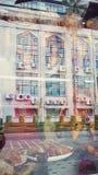 Bangkok metropolitant reflected on the roasted ducks shop window Royalty Free Stock Image