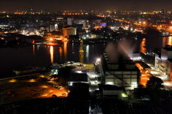 Bangkok night landscape with cooling tower and Chao Phraya River Stock Photos