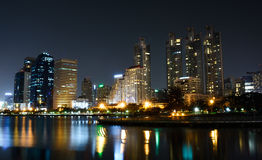Bangkok night life. Buildings and light from the garden stock photo