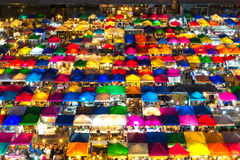 Bangkok night market. Multi-colored tents /Sales of second-hand market in Bangkok, Thailand Royalty Free Stock Images