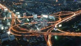 Bangkok night traffic timelapse. Night traffic at road junction timelapse in Bangkok, Thailand stock video footage