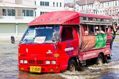 Bangkok-Nov 08 : local bus on water flooded road Royalty Free Stock Photos